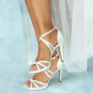 Hinoa Ivory High Heel Platform Shoes being worn against blue background
