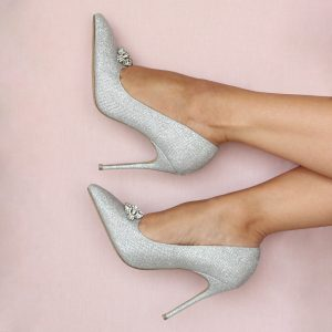 Silver High heel court shoe with pink background