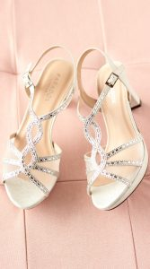 lottie-silver-occasion-shoes-on-bed